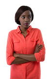 Young woman with arms crossed looking away Royalty Free Stock Image