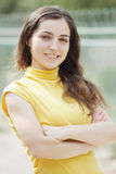 Young woman arms folded Royalty Free Stock Image