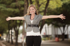Young woman with arms outstretched Stock Photo