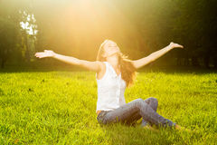 A young woman with arms outstretched Stock Images