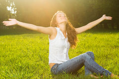 A young woman with arms outstretched Stock Photo