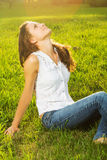 A young woman with arms outstretched Stock Photos