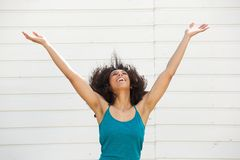 Young woman with arms outstretched Stock Images
