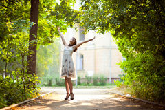 Young woman arms raised enjoying the fresh air in stock photography