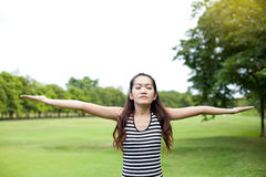 Young woman arms raised enjoying the fresh air Royalty Free Stock Image