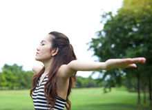 Young woman arms raised enjoying the fresh air Royalty Free Stock Images