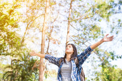 Young woman arms raised enjoying the fresh air Stock Photos