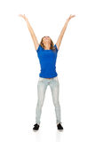 Young woman with arms raised. Stock Photography
