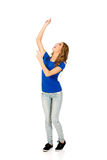 Young woman with arms raised. Stock Photo