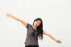Young woman with arms spread wide open Stock Photos