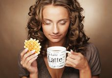 Young woman with an aromatic coffee Stock Photography