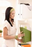Young woman arranging folders Royalty Free Stock Image