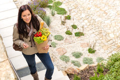 Young woman arriving home groceries shopping smiling. Garden standing royalty free stock photos