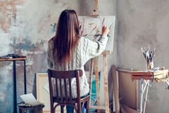 Young woman artist painting at home creative person royalty free stock image