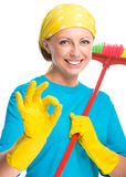 Young woman as a cleaning maid Stock Image