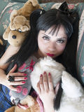 Young woman as a doll Stock Photography