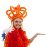 Young woman as Dutch orange supporter is showing something Royalty Free Stock Photos