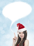 Young woman as funny christmas elf with blank space above. Young brunette woman as funny christmas elf with santa hat and blank space above stock photos