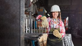 Young woman as metalworker. In metallurgy factory Stock Photos