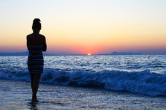 Young woman as silhouette by the sea Royalty Free Stock Photography