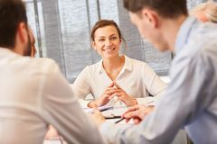 Young woman as student in meeting. Young women as student in meeting with start-up colleagues royalty free stock photography