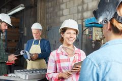 Young woman as trainee or apprentice. Young women as trainee or apprentice in metal construction stock image