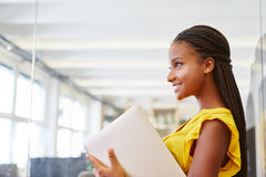 Young woman as trainee. In business apprenticeship at start-up company Stock Photo
