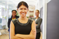 Young woman as trainee with her team Royalty Free Stock Photos