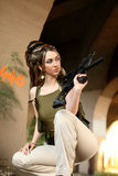Young woman with asault rifle. Stock Photography