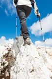 Young woman ascending a mountain ridge Royalty Free Stock Photo