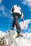 Young woman ascending a mountain ridge Royalty Free Stock Photos