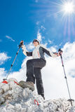 Young woman ascending a mountain Royalty Free Stock Photo