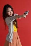 Young woman. Young asian cute woman with handgun stock photos