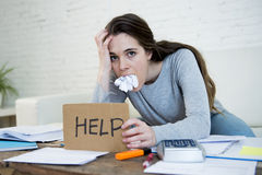 Young woman asking for help suffering stress doing domestic accounting paperwork bills royalty free stock image