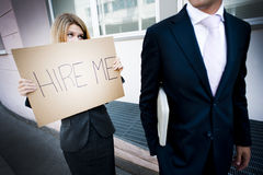 Young woman asking for a job. Man looking indifferent Royalty Free Stock Images