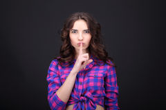 A Young woman asking to keep silent Royalty Free Stock Photo