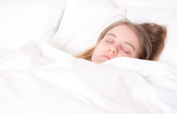 Young woman asleep in bed Royalty Free Stock Photography