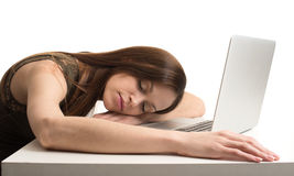 Young Woman asleep at the laptop computer Royalty Free Stock Photography