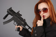 Young woman with an assault gun Royalty Free Stock Photography