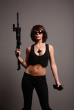 Young woman with assault gun Royalty Free Stock Images