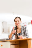 Young woman is assembling a cupboard Stock Photo