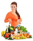 Young woman with assorted grocery products on whit Stock Images