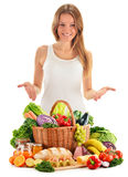 Young woman with assorted grocery products on white Stock Photos
