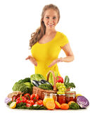Young woman with assorted grocery products on white Royalty Free Stock Photos