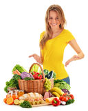 Young woman with assorted grocery products on white Royalty Free Stock Photo