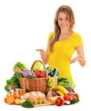 Young woman with assorted grocery products on white Stock Photo