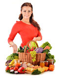 Young woman with assorted grocery products on white Royalty Free Stock Image