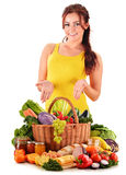 Young woman with assorted grocery products on white Stock Images