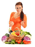 Young woman with assorted vegetables on white Stock Photos