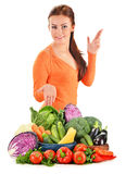 Young woman with assorted vegetables on white Royalty Free Stock Photo
